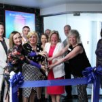 Eveline Charles Ribbon Cutting Picture